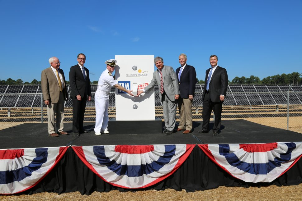 Notable ceremony presenters shake hands after the new solar farm is completed at Meridian Naval Facility